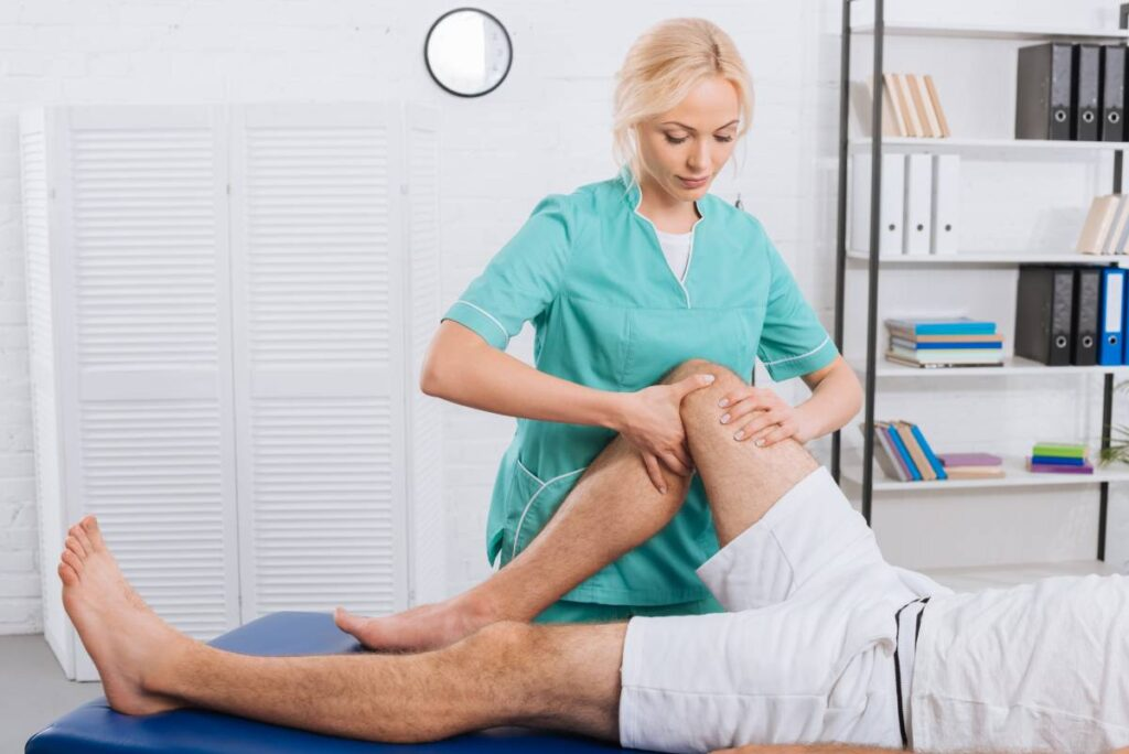 partial-view-of-chiropractor-massaging-patients